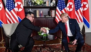 330px-Trump_and_Kim_shaking_hands_in_the_summit_room.jpg