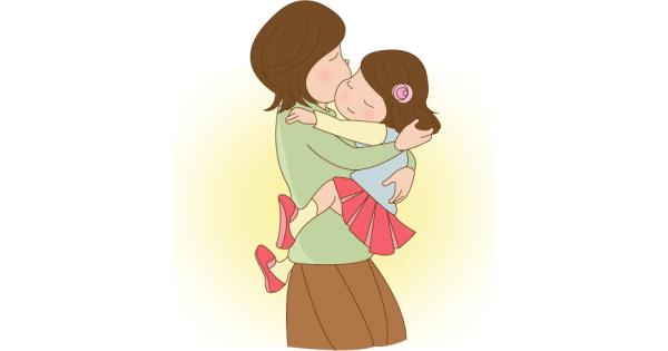 子どもを愛情たっぷりに抱っこしているお母さん