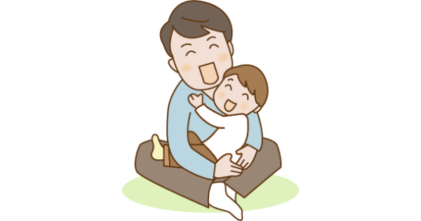 子どもをいっぱいの愛情で抱っこしているお父さん