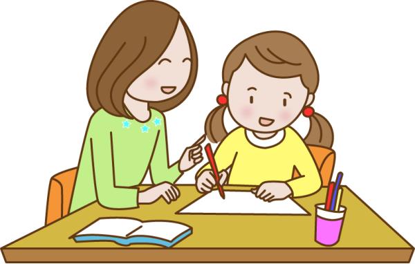 子どもの勉強を見てあげるお母さん