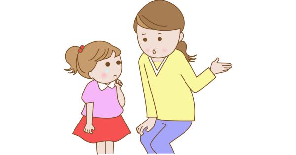 子どもにしつけをしているお母さん