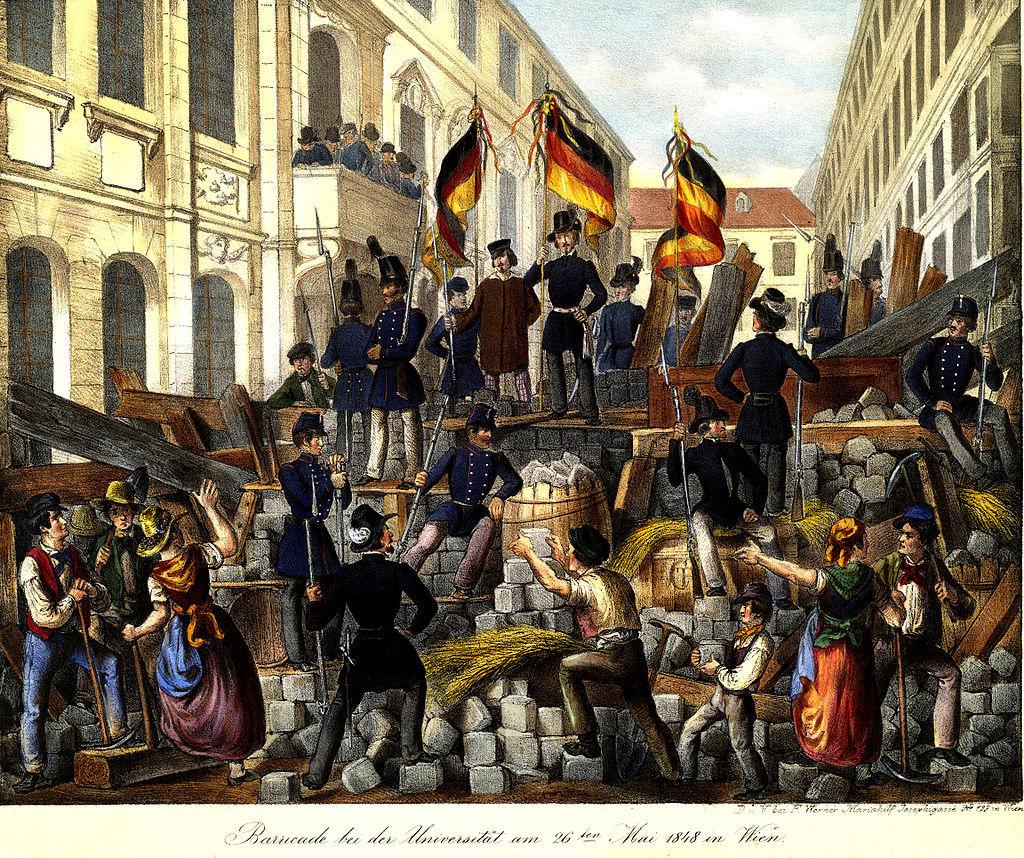 1024px-Barricade_bei_der_Universität_am_26ten_Mai_1848_in_Wien