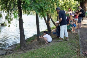 Tourists watching Water Monitor Lizard